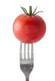 Tomate sur la fourchette Images stock