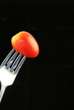 Tomate sur une fourchette Photos stock