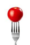 Tomate sur une fourchette images stock