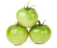 Tomate trois non mûre verte d'isolement sur le fond blanc Photo libre de droits