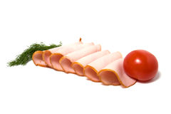 Tomate- und Fleischscheiben getrennt auf Weiß Lizenzfreies Stockfoto