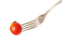Tomate und Gabel Stockfotos