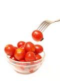 Tomate und Gabel Stockbild