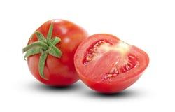 Tomate und halbes Stockfotos