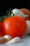 Tomate- und Knoblauchnelken Lizenzfreies Stockfoto