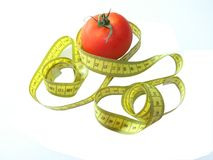 Tomate und Maßband Stockbilder