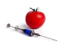 Tomate und Spritze Stockfoto