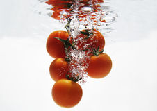 Tomate unter Wasser Stockfotografie