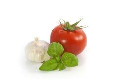 Tomate y ajo de la albahaca Imágenes de archivo libres de regalías