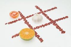 Tomate y ajo y naranja Fotos de archivo