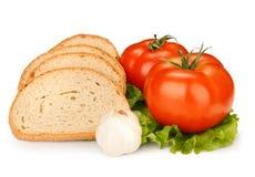 Tomate y cebolla del pan Imágenes de archivo libres de regalías