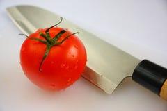 Tomate y cuchillo Imagen de archivo