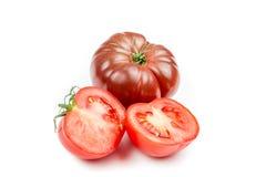 Tomate y hoja de la albahaca aislada Fotos de archivo