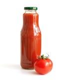 Tomate y jugo de tomate Imágenes de archivo libres de regalías