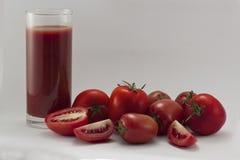 Tomate y jugo frescos Fotografía de archivo libre de regalías