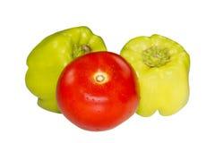 Tomate y pimienta verde Imagenes de archivo
