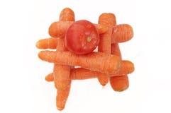 Tomate y zanahorias Imágenes de archivo libres de regalías
