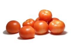 Tomaten die op wit worden geïsoleerdn Stock Foto's