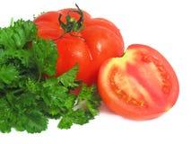 Tomaten en greens Stock Foto's
