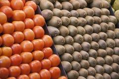 Tomaten en kiwien Stock Fotografie