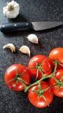 Tomaten en knoflook Royalty-vrije Stock Foto's