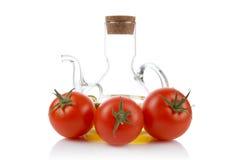Tomaten en oliebusje royalty-vrije stock afbeeldingen