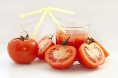Tomaten en tomatesap Stock Fotografie