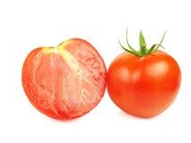 Tomaten, ganz und geschnitten Stockfotografie