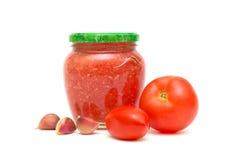 Tomaten, Knoblauch und kaukasisches Soße adjika I Lizenzfreie Stockfotografie
