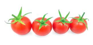 Tomaten met waterdalingen op de witte achtergrond worden geïsoleerd die Royalty-vrije Stock Foto's