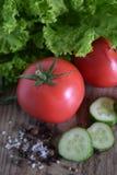 Tomaten mit Gemüse Lizenzfreie Stockbilder