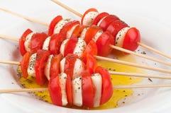 Tomaten, mozarella en olijfolie Royalty-vrije Stock Fotografie