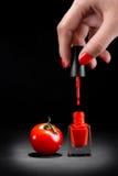 Tomaten och spikar polermedel Royaltyfri Bild