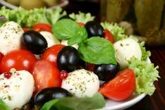 Tomaten, olijven, kaas Royalty-vrije Stock Foto's