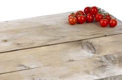 Tomaten op een lijst Stock Foto's