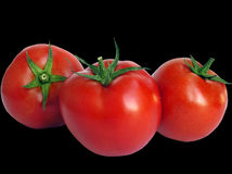 Tomaten op zwarte stock foto's