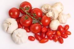 Tomaten, paddestoelen en knoflook royalty-vrije stock afbeelding