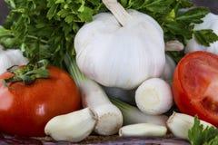 Tomaten, uien en parlseyclose-up Royalty-vrije Stock Afbeelding
