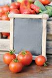 Tomaten und Preis Stockbilder