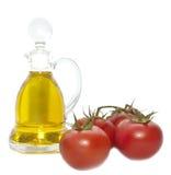 Tomaten und Schmieröl Stockfoto