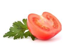Tomatengroenten en peterseliebladeren Stock Afbeelding