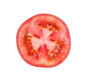 Tomatenscheibe lokalisiert auf weißem Hintergrund Lizenzfreie Stockfotografie