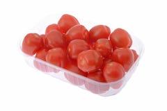 Tomater i behållare Royaltyfri Foto