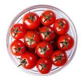 Tomater i en glass bunke Arkivbild