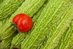 Tomater och bitter frukt- och grönsakmat ---- Royaltyfri Bild