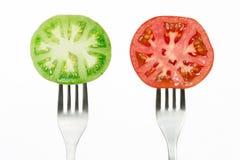 Tomater och gafflar Arkivbild