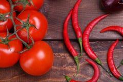 Tomater och peppar Fotografering för Bildbyråer