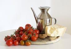 Tomater, oli och vitlök Arkivfoto