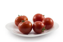 Tomater på en platta Royaltyfria Foton