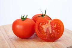 Tomater på trät Fotografering för Bildbyråer